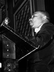Martin Luther King Jr. campaigns for President Lyndon Johnson on Sept. 27, 1964, at Cincinnati Music Hall.