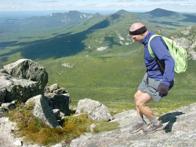 Joe McMaster walks on the summit of Mount Katahdin,