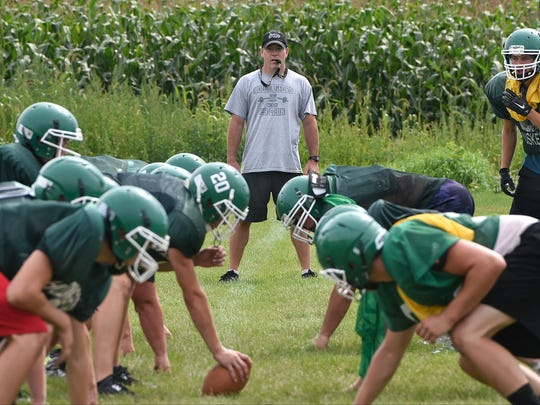 Holdingford High School head football coach Luke Mitchell watches his players during practice Thursday, Aug. 18, at the school. Holdingford has 10 players with starting experience on defense and eight with experience starting on offense back this year.
