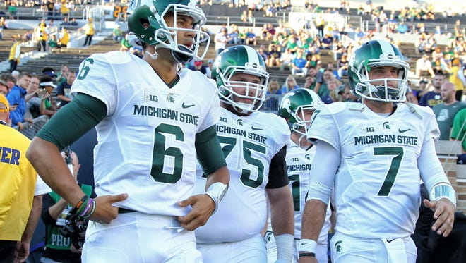 Michigan State quarterbacks Tyler O'Connor, right, and quarterback Damion Terry, left, take the field prior to MSU's game against the Notre Dame on Sept. 17.