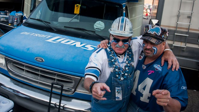 """Ron """"Crackman"""" Crachiola, and Donnie """"Yooperman"""" Stefanski pose for a photo while tailgating at Eastern Market before the Lions' game against the Redskins on Oct. 23, 2016."""