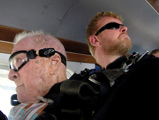 Watch 100 year old man jump out of plane for 100 year old man that jumped out the window