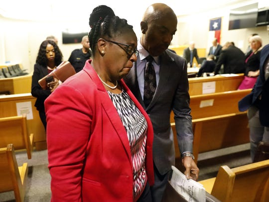 Botham Jean's mother, Allison Jean, leaves the courtroom following closing arguments in the murder trial of fired Dallas Police Officer Amber Guyger, Monday, Sept. 30, 2019, in Dallas. Guyger shot and killed Botham Jean, an unarmed 26-year-old neighbor in his own apartment in September 2018. She told police she thought his apartment was her own and that he was an intruder. (Tom Fox/The Dallas Morning News via AP, Pool)