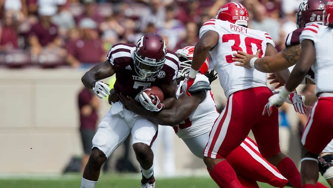 UL's Kevon Perry hauls down Texas A&M running back Keith Ford (7) last Saturday in College Station. It was one of Perry's nine tackles on the day.