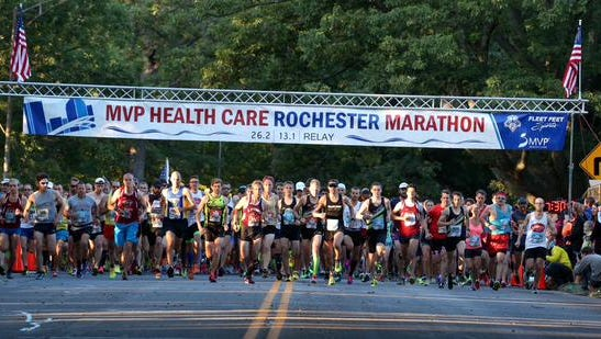 Runners take off at the start of the 29th Rochester Marathon on Sunday, Sept. 20, 2015.