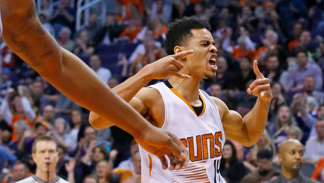 Phoenix Suns guard Gerald Green (14) celebrates late in their 120-112 win over the Denver Nuggets in their NBA Wednesday, Nov. 26, 2014 in Phoenix, Ariz.