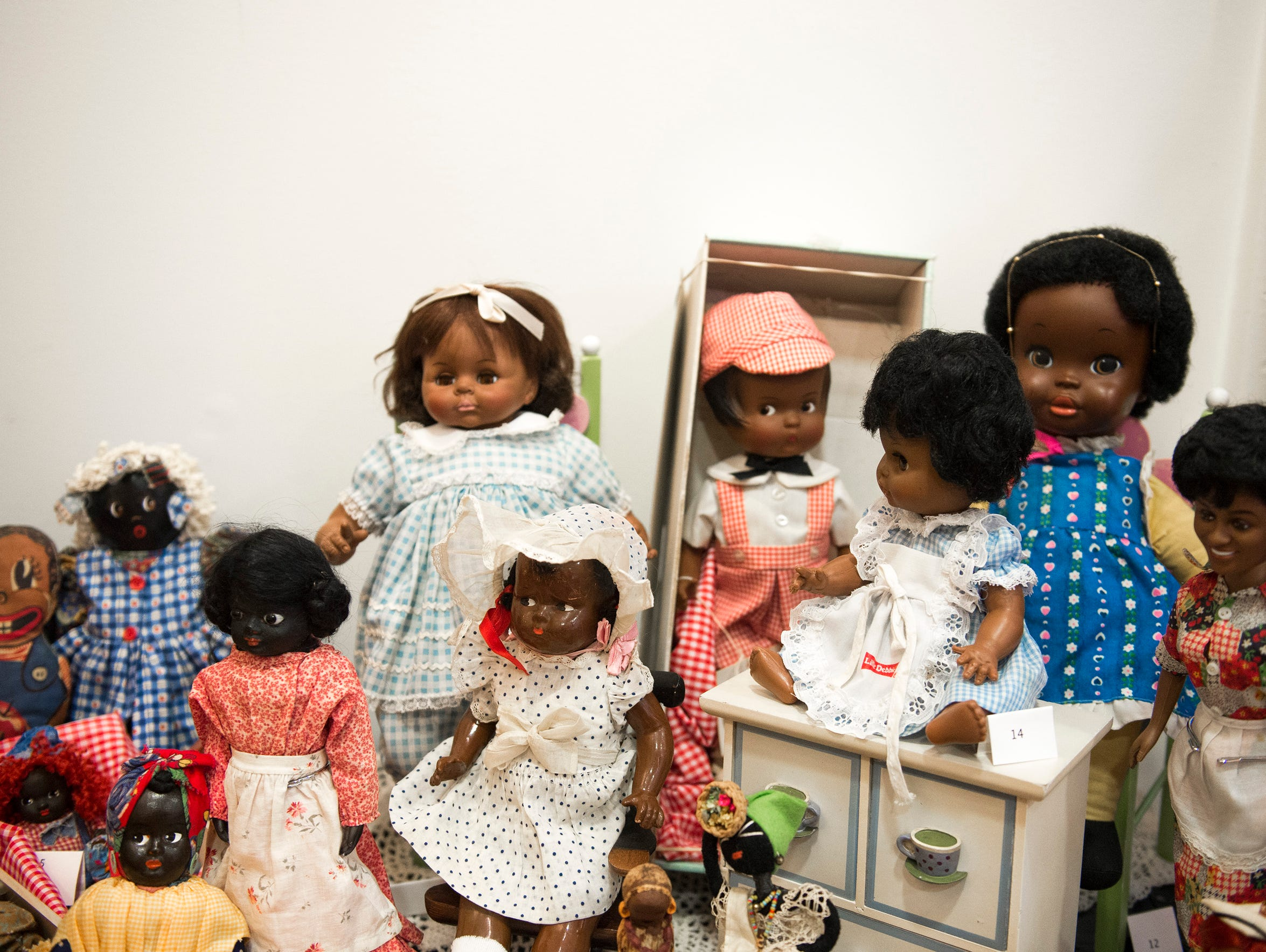 Dolls on display inside the Dolls of Distinction Exhibition