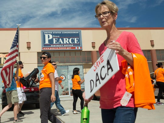 Several dozen protesters gathered in front of the Las Cruces office of U.S. Rep. Steve Pearce, R-N.M., on the fifth anniversary of the implementation of Deferred Action for Childhood Arrivals. The protesters asked Pearce to protect the the program. Tuesday Aug. 15, 2017.