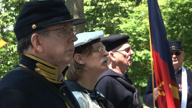 Members of the Appomattox Camp, No. 2, Sons of Union Veterans of the Civil War, and the USS Lehigh, a Civil War re-enactment and living history group, stand at attention during a Civil War Memorial Service held at Mount Salem United Methodist Church in Wilmington for Memorial Day.