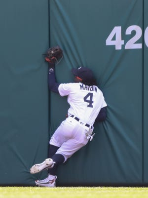 Tigers centerfielder Cameron Maybin catches a fly ball hit by Rays second baseman Steve Pearce during the second inning of the Tigers' 9-4 win Sunday at Comerica Park.