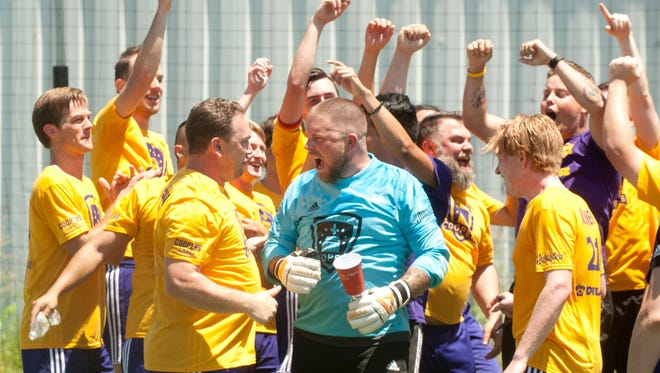 The (Louisville) Coopers celebrate their victory with their goalkeeper (center) Alex Miner. The Coopers beat The (Cincinnati) Pride, 8-1. 15 July 2017