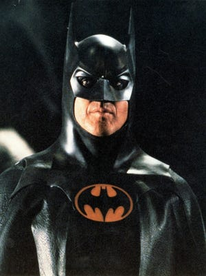 "June 17: Michael Keaton reprises his role as the Dark Knight in director Tim Burton's 1992 ""Batman Returns."" © Warner Bros"