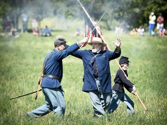 Rob Winegart of Gettysburg shouts instructions to the Federal Volunteer Brigade during Saturday's Civil War reenactment battle at Union Canal Park behind the Lebanon Valley Mall on Union Canal Drive. The 25th annual event, complete with cannons and a pitched camp, is sponsored by the 93rd Pennsylvania Volunteer Infantry, 13th Mississippi Confederate States of America and the Lebanon County Historical Society. The North and South will fight again as the event continues on Sunday. The battle is scheduled for 1:30 p.m. Admission is nonperishable food, or 2 per car.