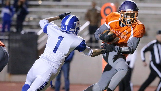 Eastlake running back Alex Vasquez gets past Bowie's Angelo Alfaro for a touchdown Thursday night in their 5A bi-district game at the Socorro Student Activities Complex.