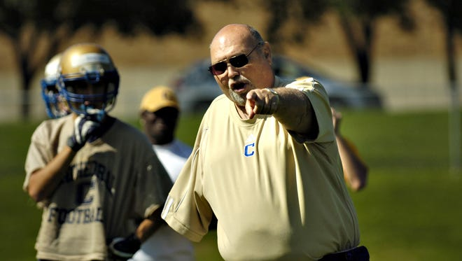 Dean Taylor, a member of the Minnesota High School Football Coaches Hall of Fame, coached at Cathedral High School.