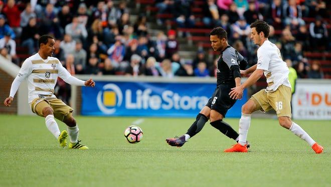 FC Cincinnati midfielder Kenney Walker (6) passes the ball upfield in the first half.