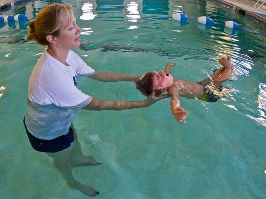 how do babies learn how to swim