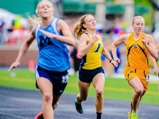Brenna Wirth, right, has starred for the Pewamo-Westphalia girls track team.