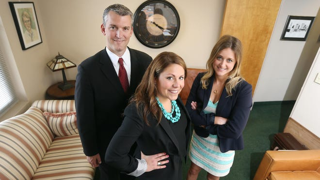 From left, attorneys Kevin Clark, Sarah Wesley and Alison Bates have joined forces and opened an office in downtown Rochester.