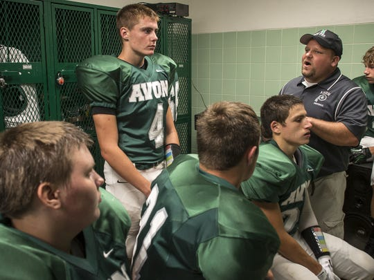 Avon coach Andy Englert talks to his team before Friday'??s home game against York.