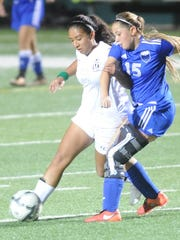 Abilene High's Gabby Valero, left, battles San Angelo Lake View's Hannah Hinojos for the ball. AHS beat the Maidens 4-1 in a nondistrict soccer game Tuesday, Jan. 10, 2017 at Shotwell Stadium.