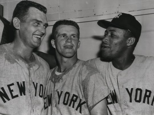 New York Yankees teammates Don Larsen (left), Milwaukee native Tony Kubek and catcher-outfielder Elston Howard celebrate a win over the Washington Senators in May 1959.