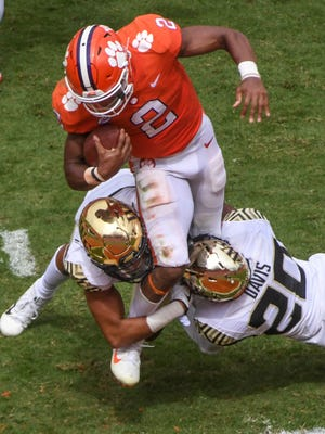 Clemson quarterback Kelly Bryant(2) gets tackled by Wake Forest defensive back Coby Davis (20) during the second quarter in Memorial Stadium at Clemson on Saturday.