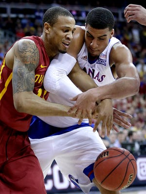 Iowa State's Bryce Dejean-Jones, left, and Kansas' Landen Lucas battle for a rebound during the first half of an NCAA college basketball game in the finals of the Big 12 Conference tournament Saturday, March 14, 2015, in Kansas City, Mo