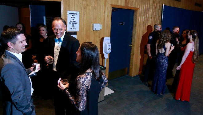 Farmington Mayor Tommy Roberts, center, talks with Jason and Abby Calcote at the San Juan County Mayors' Ball for Charity on Friday at the Farmington Civic Center.