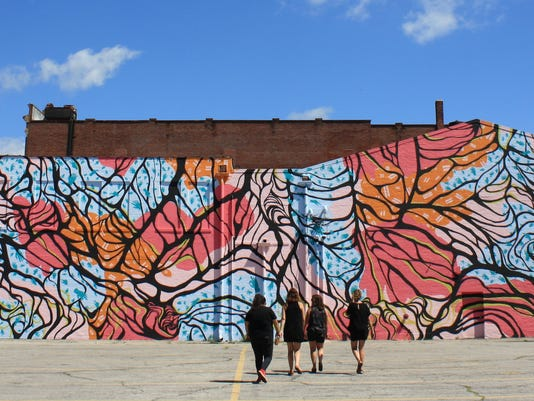 636365819726504865-Completed-mural-with-the-four-artists.JPG