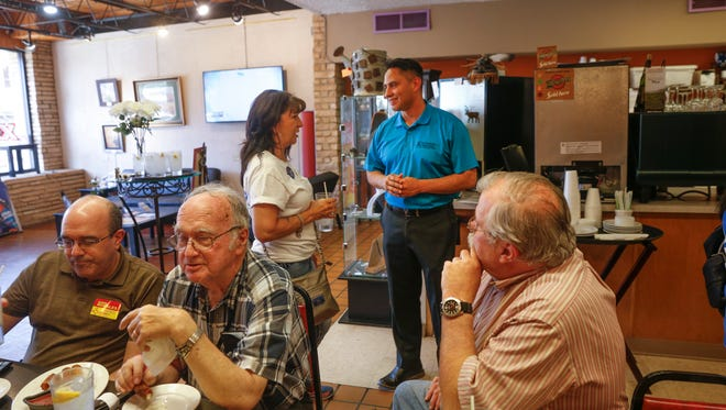 Lieutenant governor candidate Howie Morales meets with San Juan County Democratic Party members Thursday during a campaign stop at the Chile Pod in Farmington.
