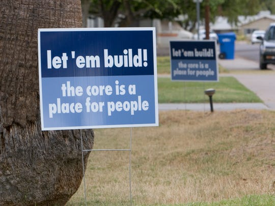 "Let 'em Build"" sign in the front yard of a residence on E. Elm St., two blocks south of Camelback Road."