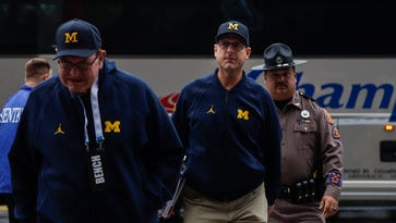 Michigan's Jim Harbaugh challenges scholarship players to earn spots