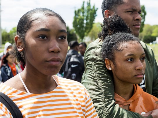 April 19, 2018 - Katelyn Cobb, left, Dejah Woodbine, front right, and Elijah Taylor watch as a balloon is released in honor of a student killed at Marjory Stoneman Douglas High School during a moment of silence as part of a student walkout at Cordova High School in Memphis, Tenn. to protest gun violence.