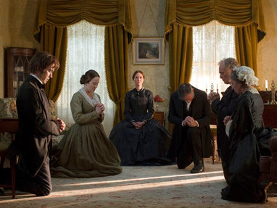 """This image released by Music Box Films shows Duncan Duff, from left, Jennifer Ehle, Cynthia Nixon, Miles Richardson, Keith Carradine and Joanna Bacon  in a scene from, """"A Quiet Passion."""""""