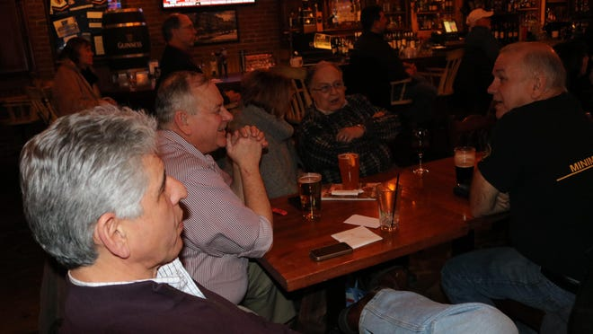 Bill Largent (front) and others talk politics at the Farmington Area Republicans meeting at Cowley's.