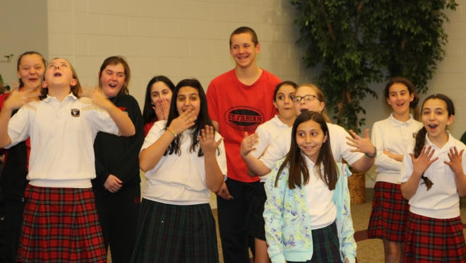 """St. Fabian students get animated as they run through a scene during a recent rehearsal for """"Little Shrek."""""""
