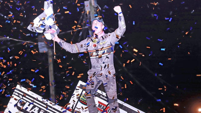Parker Parker Price-Miller, Kokomo, Indiana, celebrates his $10,000 World of Outlaws feature win at 34 Raceway Friday night.