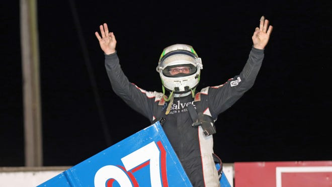Burlington's Cody Wehrle celebrates his victory in the 305 sprint car feature race Saturday night at 34 Raceway.