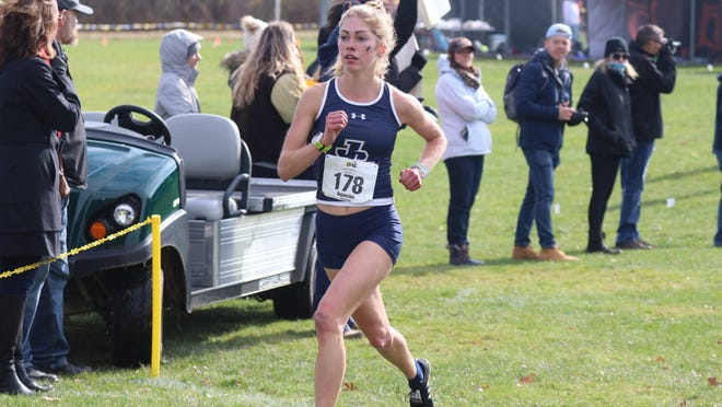 John Carroll University rising junior Cameron Bujaucius runs in a race last fall. The 2018 Hudson graduate is a three-time national qualifier despite being diagnosed with an eating disorder four years ago.