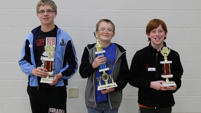 Samuel Westenberg, from left, Jacob Falkosky, and Ian Sennholz have advanced to the championship round for the Geography Bee competition.