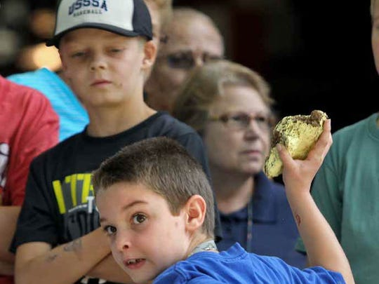 Joseph Ridgway of Johnston participates in the Kids' Cow Chip Throwing contest in 2013