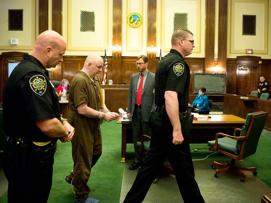 Robert Jason Owens, 37, is escorted out of the court room in handcuffs after judge Mark Powell approved the plea deal to send Owens to prison for at least 59.5 years without parole Thursday April 27, 2017 in the Buncombe County Superior Court hearing. Owens pleaded guilty for the 2015 murders of Cristie Schoen Codd, Joseph ÒJ.T.Ó Codd, and their unborn child and to two counts of dismembering human remains.