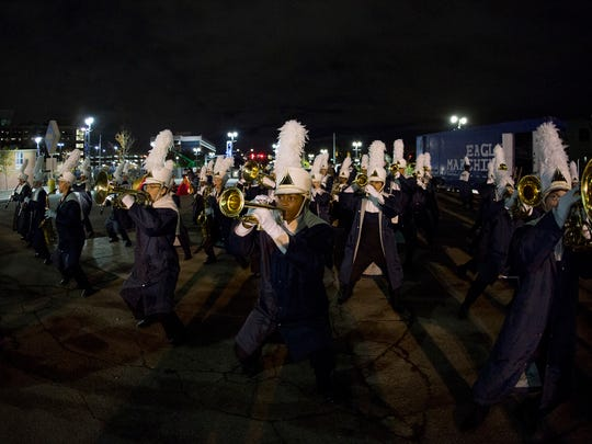 Band members practice their show in the parking lot prior to their performance at State Championships at Ford Field in Detroit, Michigan on November 4, 2017.