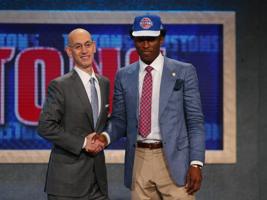 Jun 25, 2015: Stanley Johnson (Arizona) greets NBA commissioner Adam Silver after being selected as the number eight overall pick to the Detroit Pistons in the first round of the 2015 NBA Draft at Barclays Center.