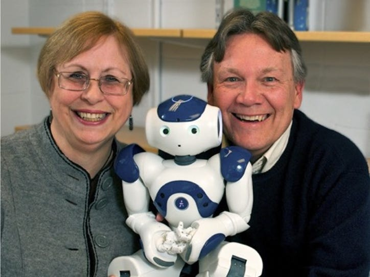 Susan and Michael Anderson with NAO, a robot they've programmed to make ethical decisions about elder care.