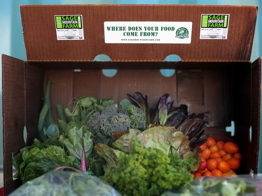 Vegetables and fruits in a CSA box from the organic Sage Mountain Farm in Azna on March 6, 2015.