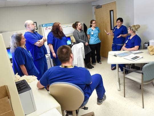Behavioral Recovery Program staff members hold a meeting Tuesday, March 27, at the St. Cloud VA Health Care System in St. Cloud.