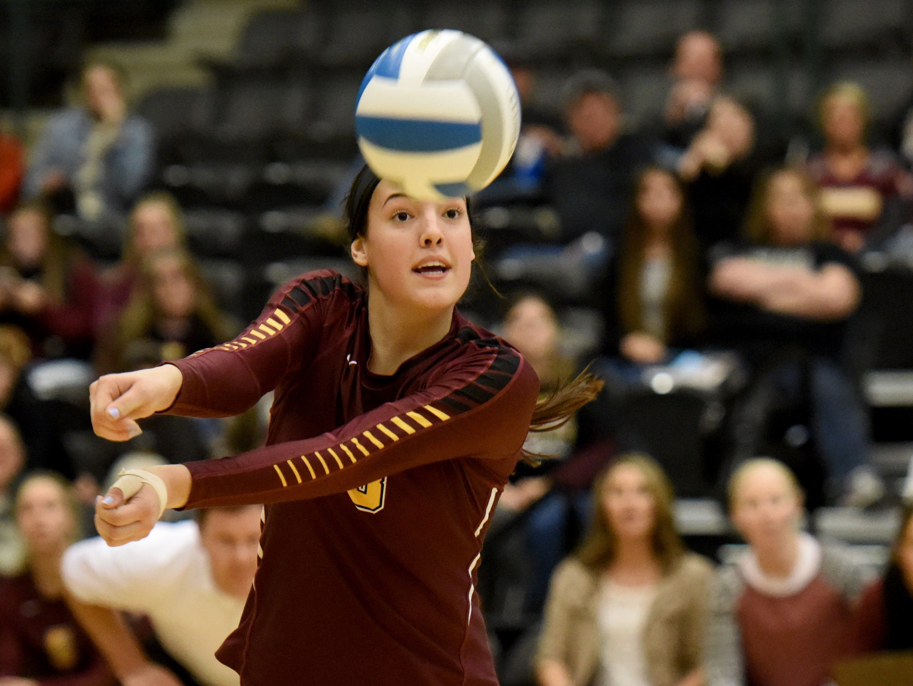 Harrisburg's Samantha Slaughter bumps the ball against Roosevelt during the S.D. State AA Volleyball championship at the Swiftel Center in Brookings.