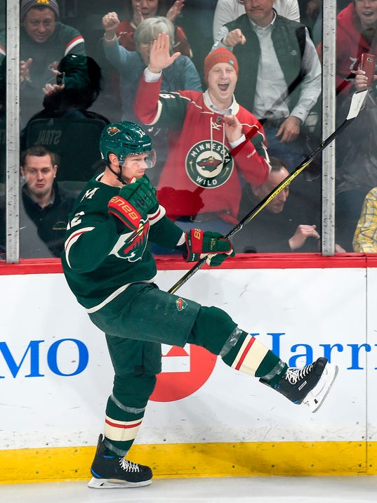 FILE - In this Feb. 13, 2018, file photo, Minnesota Wild center Eric Staal celebrates after scoring against the New York Rangers during the first period of an NHL hockey game, in St. Paul, Minn. The Wild face the Winnipeg Jets in Game 1 of a first round playoff series on Wednesday, April 11, 2018, in Winnipeg. (AP Photo/Craig Lassig, File)